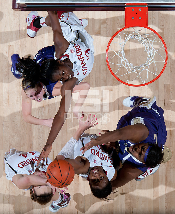 STANFORD, CA - February 12, 2011: Chiney Ogwumike, Kayla Pedersen and Nnemkadi Ogwumike of the Stanford Cardinal women's basketball team stretch for the rebound during Stanford's 62-52 win over Washington at Maples Pavilion.