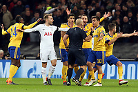 Junentus players surround the referee asking for a penalty during Tottenham Hotspur vs Juventus, UEFA Champions League Football at Wembley Stadium on 7th March 2018