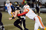 WATERBURY, CT-112117JS15- WCA's Christian Calle (23) gets tackled from behind by Gilbert-Northwestern's Liam Duran (50) during their game Tuesday at Municipal Stadium in Waterbury. <br /> Jim Shannon Republican-American