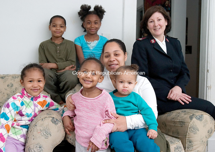 WATERBURY, CT. 13 April 2010-041310SV11--Emily Becker sits with her four children. They are Neftali McNeil, Jasmine Becker, 5, Michelle Becker, 3, and  Reniza Becker,1 at their home in Waterbury. Members of The Salvation Army in Waterbury are working with the needy family to get them housing and then paint the children's rooms. At right, Major Annette Lock of the Salvation Army. Also in Photo (? see Tracy O&rsquo;Shaughnessy &ndash; she is getting name)<br /> Steven Valenti Republican-American