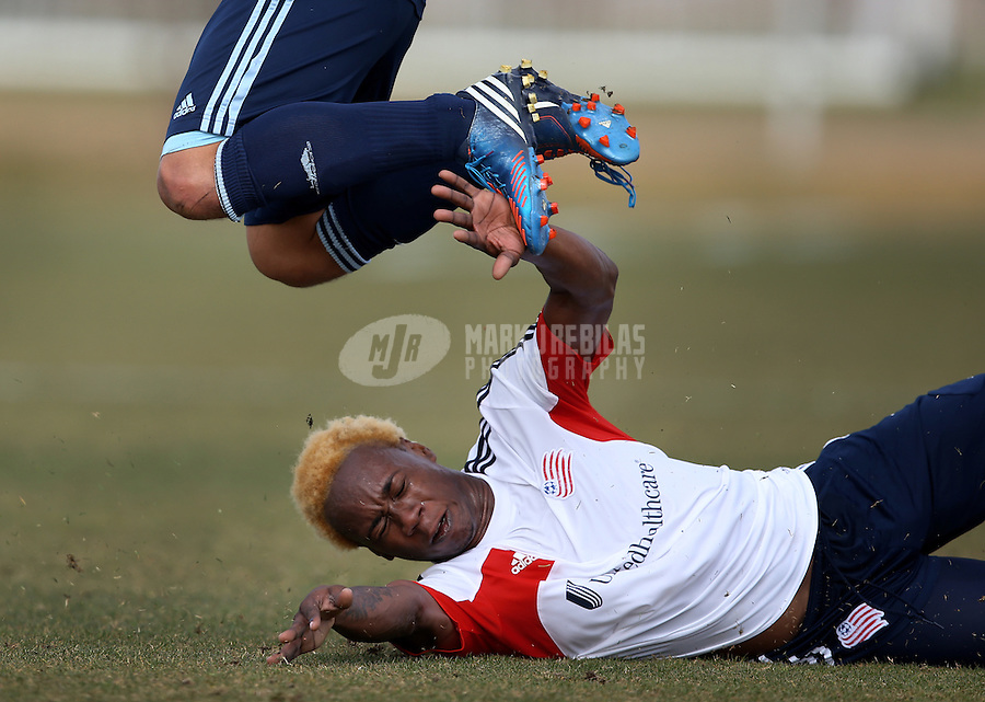Jan. 25, 2013; Casa Grande, AZ, USA: New England Revolution defender Quinton Griffith reacts as he slides beneath the cleats of a Sporting KC player during a preseason game at Grande Sports World. Mandatory Credit: Mark J. Rebilas-USA TODAY Sports