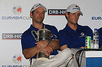 Paul Casey (Team Europe) holds on tight to the Eurasia Cup during a post match interview after winning the Eurasia Cup at Glenmarie Golf and Country Club on the Sunday 14th January 2018.<br /> Picture:  Thos Caffrey / www.golffile.ie