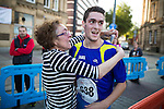 © Joel Goodman - 07973 332324 . 20/09/2015 . Stockport , UK . Winner JAKE LITTLEHALES (23 from Stockport ) is congratulated by his tearful mother . The Big Stockport run from St Petersage in Stockport Town Centre . Photo credit : Joel Goodman