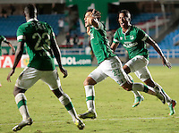 CALI -COLOMBIA-26-03-2014. Nestor Camacho (C) jugador del Deportivo Cali de Colombia celebra gol anotado a O'Higgins de Chile durante partido de vuelta por la primera fase llave G3, de la Copa Bridgestone Libertadores 2014 jugado en el estadio Pascual Guerrero de la ciudad de Cali. / Nestor Camacho (C) player of Deportivo Cali of Colombia celebrates a goal scored to O'Higgins de Chile during a match for the second leg for the first phase, G3 key, of the Copa Bridgestone Libertadores 2014 played at Pascual Guerrero stadium in  Cali city. Photo: VizzorImage/ Juan C. Quintero /STR