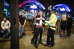 """© Joel Goodman - 07973 332324 . 19/12/2015 . Manchester , UK . Revellers in Manchester enjoy """" Mad Friday """" - also known as """" Black Eye Friday """" - the day on which emergency services in Britain are typically at their busiest , as people head out for parties and drinks to celebrate Christmas . Photo credit : Joel Goodman"""