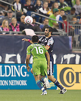 New England Revolution midfielder Monsef Zerka (19) controls the ball. In a Major League Soccer (MLS) match, the Seattle Sounders FC defeated the New England Revolution, 2-1, at Gillette Stadium on October 1, 2011.