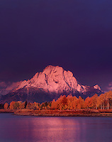 749450328v dawn lights up mount moran and the teton range during a clearing storm and highlights the fall colored aspens along the oxbow bend of the snake river in grand tetons national park wyoming