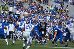 Quarterback Reese Phillips (12) passes the ball down the field during the Blue/White Spring Game in Lexington, Ky., on Saturday, April 26, 2014. Blue defeated White 38-14. Photo by Adam Pennavaria | Staff