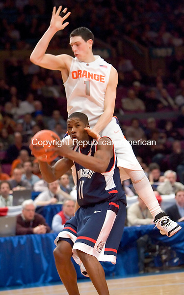 NEW YORK, NY--07 MARCH 2007--030707JS04-UConn's Jerome Dyson gets fouled by Syracuse's Andy Rautins during their Big East tournament game Wednesday at Madison Square Garden in New York City. UConn lost 78-65.<br /> Jim Shannon / Republican-American