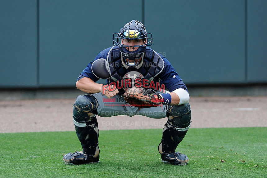 Catcher Peter O'Brien (9) of the Charleston RiverDogs works on blocking pitches before a game against the Greenville Drive on Sunday, May 19, 2013, at Fluor Field at the West End in Greenville, South Carolina. O'Brien was a second-round pick of the New York Yankees in the 2012 First-Year Player Draft. Charleston won, 9-7. (Tom Priddy/Four Seam Images)