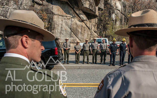 Yosemite National Park, CA—Dog Rock Fire—Yosemite National Park Rangers  transfer the body of the Cal Fire pilot killed in an airplane crash in Yosemite National Park on Tuesday, October 7. The formal ceremony included the Cal Fire Honor Guard and marked the transition  from Yosemite National Park to Cal Fire. The ceremony was conducted at the entrance to Yosemite on Highway 140 near El Portal, CA, today Wednesday, October 08, 2014.  Photo By Al Golub/Golub Photography