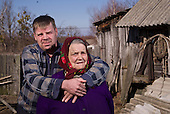 Sergei, 44, and his mother Maria, 78, resettlers at the radioactive exclusion zone at Chernobyl. <br /> <br /> 30 years on, the plant is still heavily contaminated, unfit for human life, but some villages defy government orders and returned to live inside the exclusion zone. <br /> <br /> The Chernobyl nuclear disaster happened on 26 April 1986.