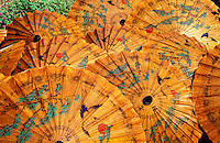 Thailand.  Lacquered paper parasols, Chiang Mai.