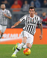 Calcio, Serie A: Lazio vs Juventus. Roma, stadio Olimpico, 4 dicembre 2015.<br /> Juventus&rsquo; Mario Mandzukic in action during the Italian Serie A football match between Lazio and Juventus at Rome's Olympic stadium, 4 December 2015.<br /> UPDATE IMAGES PRESS/Riccardo De Luca