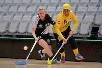 New Zealand's Emma Molander and Malaysia's Nor Saliza Binti Ahmad Soobni in action during the World Floorball Championships 2017 Qualification for Asia Oceania Region - New Zealand v Malaysia at ASB Sports Centre , Wellington, New Zealand on Saturday 4 February 2017.<br /> Photo by Masanori Udagawa<br /> www.photowellington.photoshelter.com.