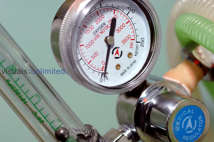 Close up of a pressure meters for oxygen tanks, attached to a regulator Royalty Free