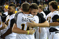 Jacksonville Suns pitcher Justin Nicolino (22) hugs Austin Barnes (16) after game three of the Southern League Championship Series against the Chattanooga Lookouts on September 12, 2014 at Bragan Field in Jacksonville, Florida.  Jacksonville defeated Chattanooga 6-1 to sweep three games to none.  (Mike Janes/Four Seam Images)