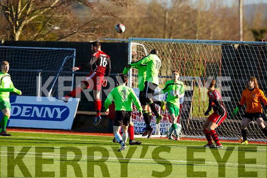 Anthony Fealy AC Athletic and Farouk Amin of Killarney Celtic jump highest as the ball is delivered into the goalmouth during their game in Mounthawk Park on Sunday last.