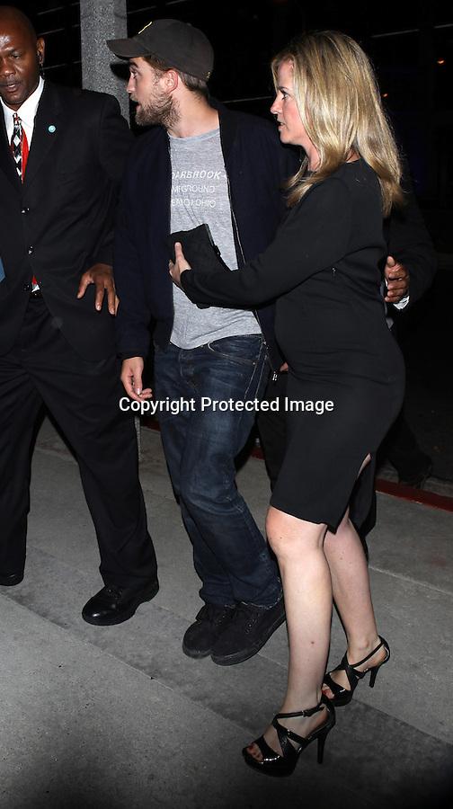 Sunday night August 28, 2010..Robert Pattinson with a beard leaving SoHO House in west Hollywood with his mom...AbilityFilms@yahoo.com.805-427-3519.www.AbilityFilms.com.