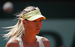 Maria Sharapova of Russia look at Andrea Petkovic of Germany in the quarter final match of the French Open tennis tournament in Roland Garros stadium in Paris, Wednesday June 1, 2011.(foto: Srdjan Stevanovic/Starsportphoto ©)