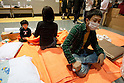 Saitama, Japan - A photo made available on March 22, 2011 shows Mamoru Sakai, 40, a truck driver from Iwaki, Fukushima thinking what the next move is for him and his family at Saitama Super Arena, a temporary shelter in Saitama, north of Tokyo. They have been staying at the shelter since March 18 as Mamoru feared for his family's saftey due to the radiation crisis. Thousands of residents from Fukushima evacuated their town as high levels of radiation continued to be a high risk from the quake-hit nuclear plant. (Photo by Christopher Jue/Nippon News/AFLO)