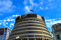 The NZ flag flies at half mast above the Beehive. Members of the NZ Parliament pay tribute to Christchurch terror attack victims at Parliament in Wellington, New Zealand on Monday, 18 March 2019. Photo: Dave Lintott / lintottphoto.co.nz