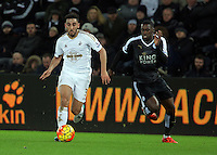 Neil Taylor of Swansea against Jeff Schlupp of Leicester City during the Barclays Premier League match between Swansea City and Leicester City at the Liberty Stadium, Swansea on December 05 2015