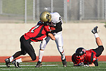 Palos Verdes, CA 11/10/10 - Adam Hahn (Palos Verdes # 27) and Nathan Jo (Peninsula #12) in action during the junior varsity football game between Peninsula and Palos Verdes at Palos Verdes High School.