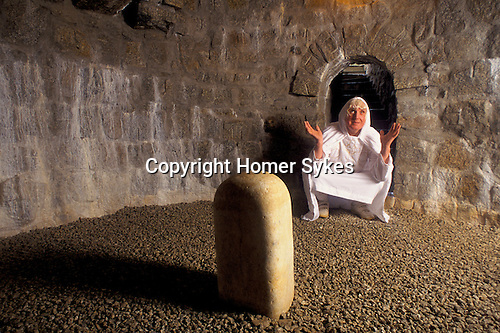 DRUID GARDEN GLYNIS ED PRYNN IN SOUTERRAIN CHAMBER, WHICH THEY CALL A REBIRTHING CHAMBER WITH A POLISHED DREKLY STONE