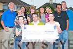 CANCER RESEARCH: The member's of the Tralee cancer research fund-raising committee who held a head-shave at the Barbers and raised EUR7,853 for cancer research presenting the proceeds of the night to the Cancer Society on Tuesday (10/06/08) front l-r: Trish Howell, Kevin Delaney, (Cancer society) and Jackie Landers. Back l-r: Sean Hickey, Luke Allen, Maureen O'Sullivan, Teresa Hickey, Karen O'Connor, Triona O'Keeffe, Seif Taher and Joe O'Brien, (The Barbers).    Copyright Kerry's Eye 2008