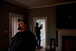 "Chris Carter (right) takes photos as his colleague Chris Phillips (left) listens for sounds in an upstairs room of ""The Painted Lady,"" a former guest house that was built in 1870, during an investigation by Twisted Dixie. The ""paranormal investigators"" of Twisted Dixie are Grady Carter, Andy Carter, Chris Carter (all related), and Chris Phillips, seen in South Carolina November 4, 2011. The team did an investigation in the historic house with a medium on a previous night and were back to gather more video and still photos."