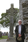Fr Michael Hickey on front of the West Cross at Monasterboice, Co.Louth...(Photo credit should read Jenny Matthews www.newsfile.ie)....This Picture has been sent you under the conditions enclosed by:.Newsfile Ltd..The Studio,.Millmount Abbey,.Drogheda,.Co Meath..Ireland..Tel: +353(0)41-9871240.Fax: +353(0)41-9871260.GSM: +353(0)86-2500958.email: pictures@newsfile.ie.www.newsfile.ie.