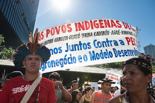 Indigenous people with a banner protest outside BNDES, the Brazilian Development Bank, after marching from the People's Summit at the United Nations Conference on Sustainable Development (Rio+20), Rio de Janeiro, Brazil, 18th June 2012. Photo © Sue Cunningham.