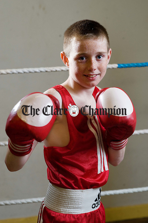 Ennis lad Paddy Donovan who boxes with Our Lady Of Lourdes club in Limerick,  won the Boy 1. 36kg title at the Munster Championships. He is pictured in training at Ennis Boxing Club. Photograph by John Kelly.