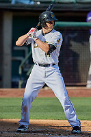 Dustin Garneau (14) of the Salt Lake Bees bats against the Albuquerque Isotopes at Smith's Ballpark on April 27, 2019 in Salt Lake City, Utah. The Isotopes defeated the Bees 10-7. This was a makeup game from April 26, 2019 that was cancelled due to rain. (Stephen Smith/Four Seam Images)