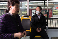 "Tony (Chinese name withheld), a 32-year old office worker rides a bus home during his lunch break in central Beijing. ""From 2013, I started using the mask. At that time the media reported the air was very serious. It was the first time it was said to be smog"", he explains. He uses online apps to monitor the air pollution levels each day. ""If the index is over 200, I use it. Over 400? You must use it! I've asked my family and friends to wear the mask, especially when it's over 200"". PM2.5 reading - 212 - Very Unhealthy"