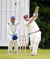 Ed Binns hits our for Highgate during the ECB Middlesex Division Three game between Highgate and Harrow Town at Park Road, Crouch End on Saturday May 24, 2014