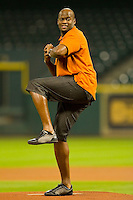 Former Texas Longhorns quarterback Vince Young winds up to throw out the ceremonial first pitch prior to the game between the Texas Longhorns and the Rice Owls at Minute Maid Park on March 2, 2012 in Houston, Texas.  Brian Westerholt / Four Seam Images