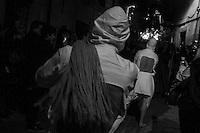 Body as Sacrifice. LA RIOJA, 2013-14. La Procesi&oacute;n de los &ldquo;Picaos&rdquo; se celebra todos los a&ntilde;os en San Vicente de la Sonsierra en la Rioja (Espa&ntilde;a). Es la &uacute;nica tradici&oacute;n religiosa en Espa&ntilde;a en la que la flagelaci&oacute;n es tomada como forma de penitencia.<br /> Los &ldquo;Picaos&rdquo; ofrecen su cuerpo como sacrificio golpe&aacute;ndose la espalda con unas madejas de esparto y algod&oacute;n. Para ellos es una forma de ruego a Dios para que escuchen sus plegarias; es una forma intima de manifestar su devoci&oacute;n y una forma de crear una conexi&oacute;n directa con Dios. Para participar en el ritual una tiene que ser hombre, mayor de edad y tener un certificado de su cristiandad de su p&aacute;rroco.<br /> La procesi&oacute;n tiene lugar en completo silencio. Los &ldquo;Picaos&rdquo; caminan por los estrechas calles del pueblo con un &ldquo;hermano cofrade&rdquo;. &Eacute;l vigilar&aacute; sus heridas y le servir&aacute; como guia espiritual. El nombre de &ldquo;Picaos&rdquo; viene dado por el acto de &ldquo;picar&rdquo; las llagas que se forman en el lumbar tras casi setecientos golpes, con una &ldquo;esponja&rdquo; de cera recubierta de 12 peque&ntilde;os cristales que permitir&aacute;n la mejor cicatrizaci&oacute;n de las heridas. Despu&eacute;s se limpiar&aacute;n con agua de romero. &copy;Adri&aacute;n Irago