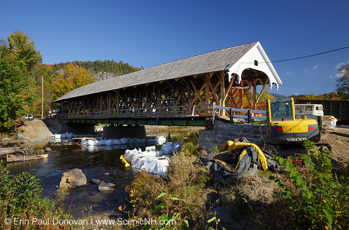 The village of Stark in Stark, New Hampshire USA during the autumn months. At the time of this photo in 2014 the covered bridge was be worked on.