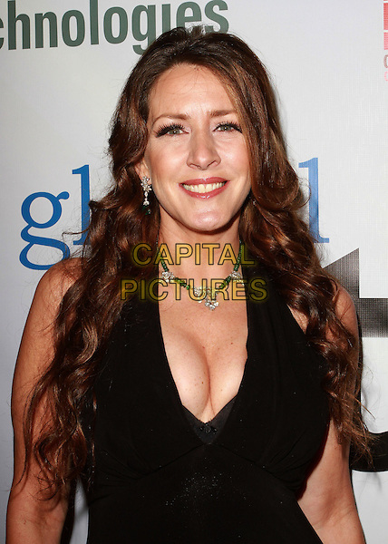 JOELY FISHER .First Annual Global Action Forum Gala Held At The Beverly Hilton Hotel, Beverly Hills, California, USA, .18th Febuary 2011..portrait headshot smiling necklace  cleavage halterneck  black.CAP/ADM/KB.©Kevan Brooks/AdMedia/Capital Pictures.