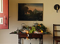 This elaborate still life is inspired by a book on Dutch art and life and the painting is from the Hudson River School