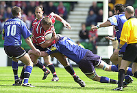 Sport - Rugby 28/04/2002 Parker Pen Shield - Semi-Final.Gloucester vs Sale - Franklin Gardens - Northampton.Ed Pearce is tackled by Ian Fullerton..[Mandatory Credit, Peter Spurier/ Intersport Images].