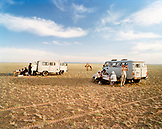 MONGOLIA, Nemegt Basin, after a day of riding camels the riders end at a campsite and dinner in the Gobi desert