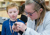 NWA Democrat-Gazette/CHARLIE KAIJO  Instructor Erin Bahnmaier (right) helps Patrick McAuley, 9, (left) make a circuit, Monday, November 25, 2019 during a two-day Mad Science camp at the Bentonville Community Center in Bentonville.<br /> <br /> Kids built circuits and learned how electricity flows in a two-day science camp led by a group of educators called Mad Science. They focused on how robots have a purpose and how they can determine that purpose. Their focus is to get kids excited about science through hands on activities. They partnered with the Bentonville Community Center to hold camps since the summer of 2018.