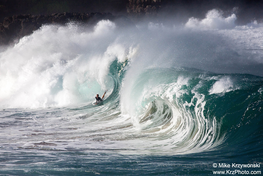 Bodyboarder Riding Waimea Shorebreak Wave, O'ahu