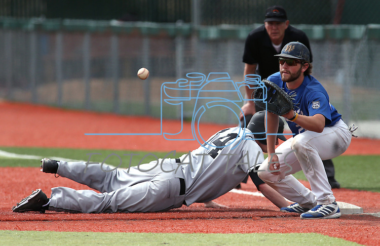 Mt. Hood's Jake Azavedo dives back safely past Western Nevada College's Spenser Dorsey at John L. Harvey Field in Carson City, Nev., on Friday, March 14, 2014. <br /> Photo by Cathleen Allison/Nevada Photo Source