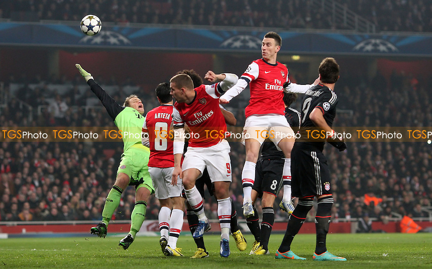 Laurent Koscielny of Arsenal rises highest - Arsenal vs Bayern Munich, Champions League 1st Knock Out Round, 1st Leg at Arsenal Stadium, Arsenal - 19/02/13 - MANDATORY CREDIT: Rob Newell/TGSPHOTO - Self billing applies where appropriate - 0845 094 6026 - contact@tgsphoto.co.uk - NO UNPAID USE.