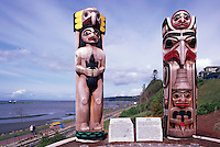 White Rock, BC, British Columbia, Canada - Coast Salish and Haida Totem Poles in Lions Park, along Seaside Promenade Walkway and Semiahmoo Bay, Autumn / Fall