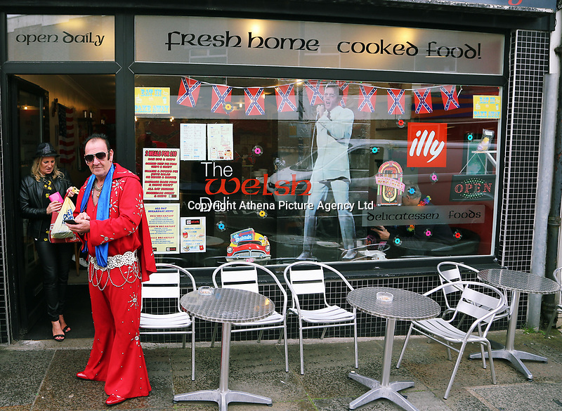 Pictured: An Elvis Presley fan in a red costume stands outside a tea house. Friday 22 September 2017<br />